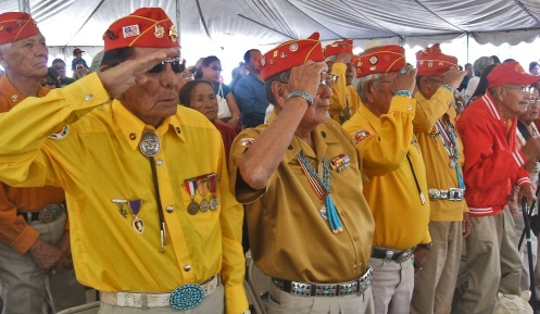 Navajo Code Talkers stand and salute as the colors are posted during Code Talkers Day event in Window Rock, Ariz., Aug. 14. Photo courtesy of Morris Bitsie